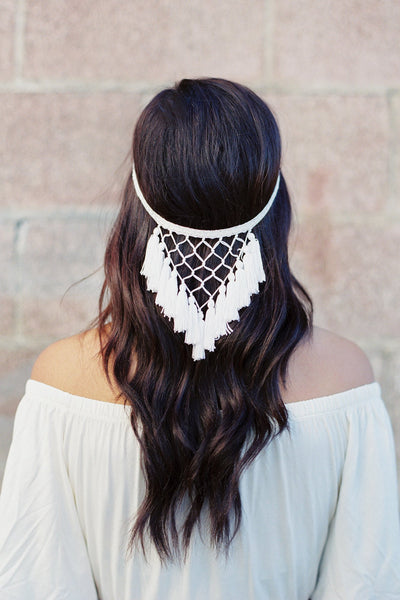 Danani Style #215 | Bohemian bride with long wavy hair wearing dreamcatcher fringe halo headpiece with tassels and macrame. This easy to wear lace reverse crown hairpiece is perfect for a beach wedding. | Loblee Photography