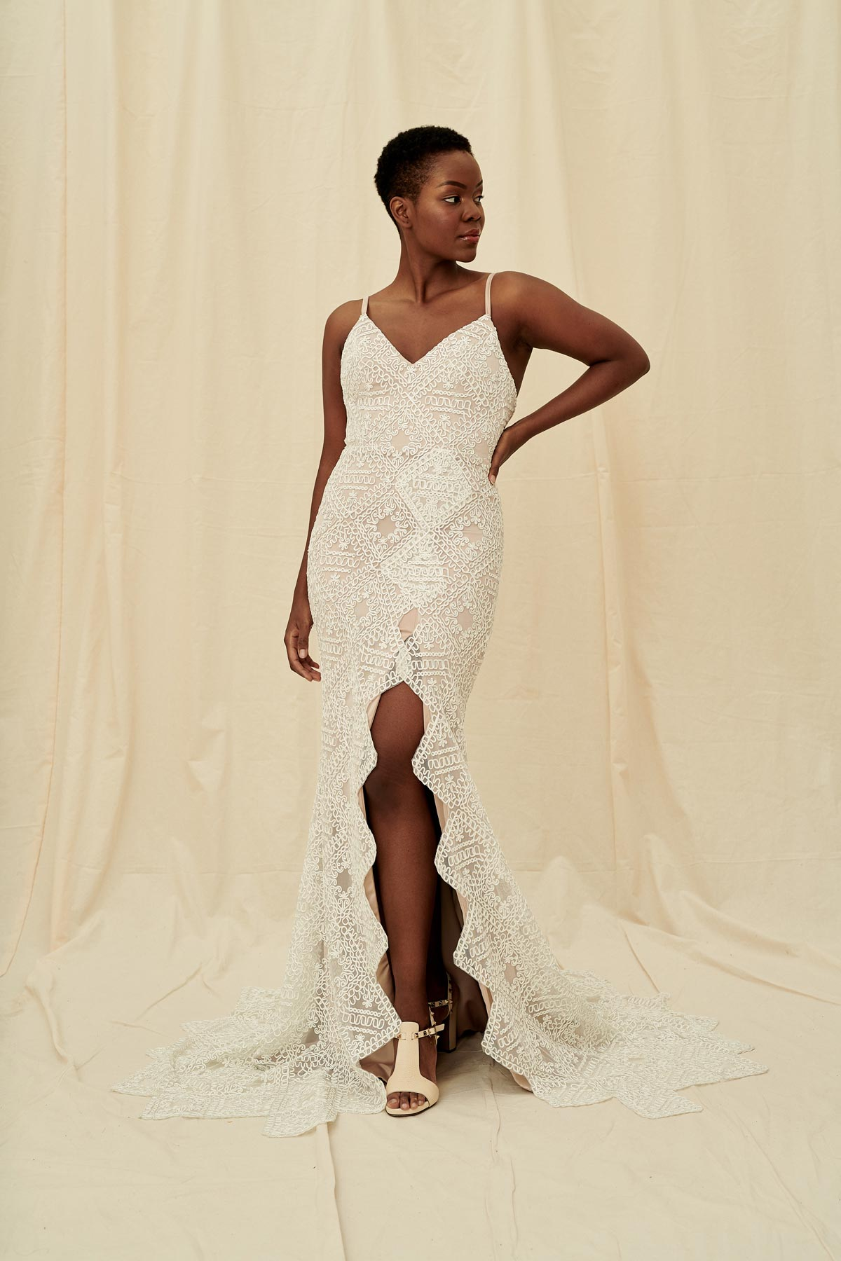 A unique wedding dress with a zigzag slit, geometric lace and a low back