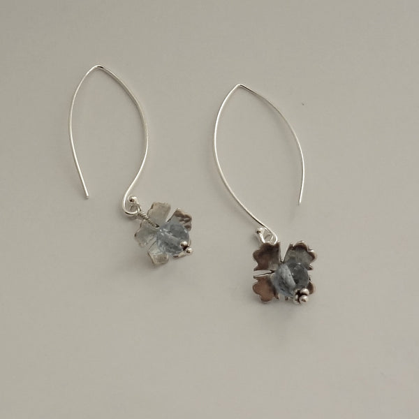 Sterling Silver and genuine Blue topaz handmade earrings.  2.25 inches overall length. Pretty, subtle, chic.  Jan David Design Jewelers and All Animal Jewelry.