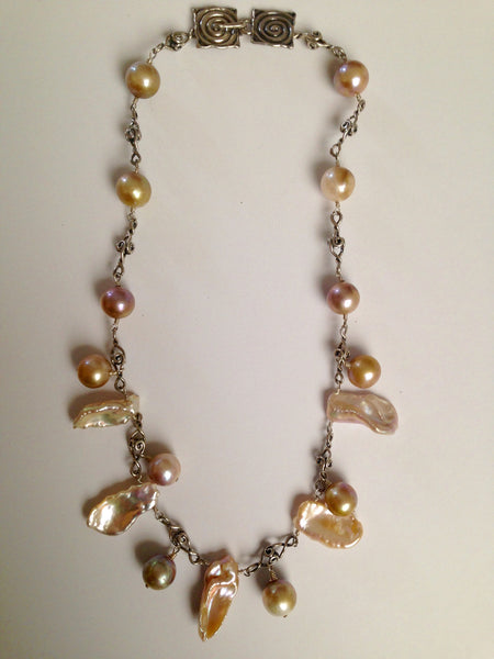 Unique tribal cultured pearl strand with sterling silver
