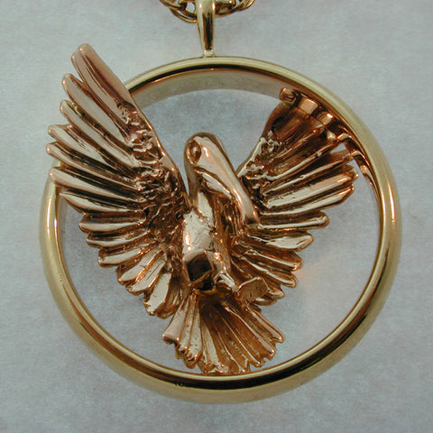 Rose Gold Pelican Pendant also available in Sterling or 14k gold  handmade in Sterling or 14k gold by Tosa Fine Jewelry