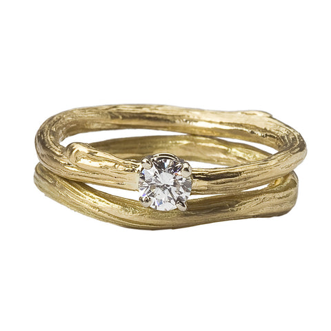 Ideal twig engagement ring paired with our classic twig wedding band.  Prong set brilliant diamond.  Inspired by nature and beautifully rendered in 18K gold.