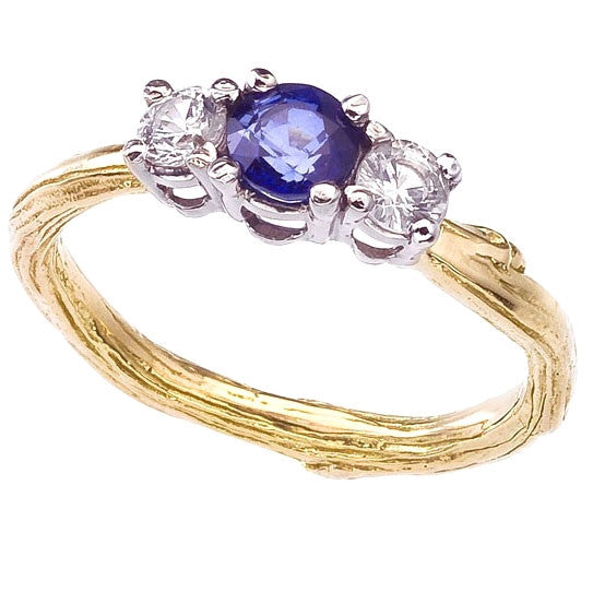 Sapphires in blue and white sparkle on this three stone twig engagement ring. Designed by Barbara Polinsky.