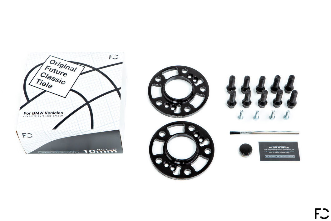 Everything included in the Future Classic wheel spacer set for BMW models: wheel spacer pair, lug bolts, hub bolts, applicator brush, Copaslip copper anti-seize