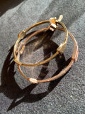Double bangle in gold and rose gold