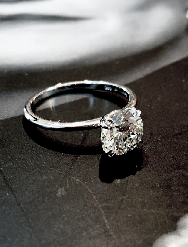 Delicate diamond solitaire with double claw prongs in platinum custom made in nyc - Bailey