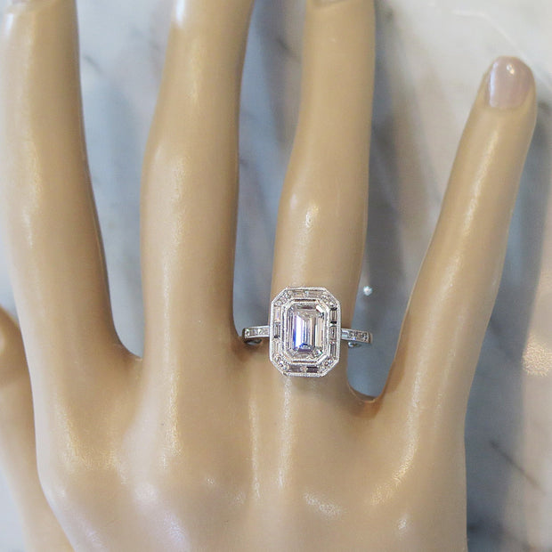 Emerald Cut Diamond Halo with Baguette & Round Diamond Accents on Hand