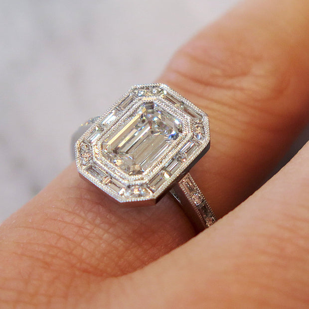 Custom Emerald Cut Diamond Halo with Baguette and Rounds on Hand