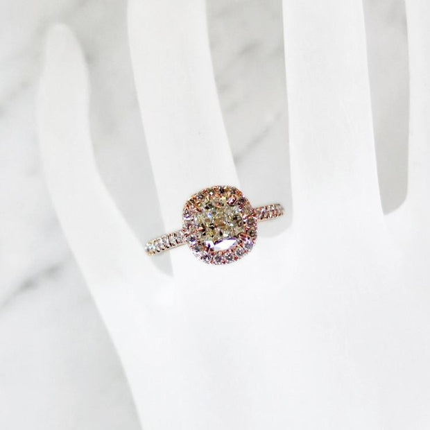 Delicate cushion cut diamond halo with light yellow diamond in rose gold on hand - Shelby