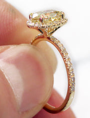 Linza yellow diamond engagement ring on hand in yellow gold - delicate, thin, low-profile