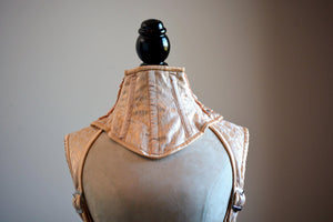A satin and mesh corsetted collar laced at the back, different colors available.