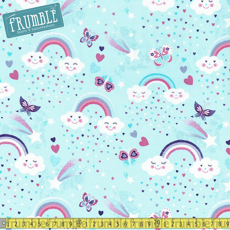 Unicorn Kisses Rainbow & Clouds Light Blue Fabric by Studio E