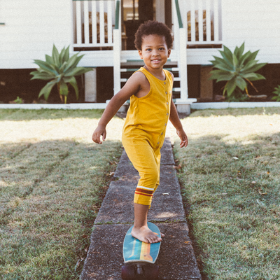 Adorable boy in the my brother john mustard yellow romper from the happy little vegemite collection