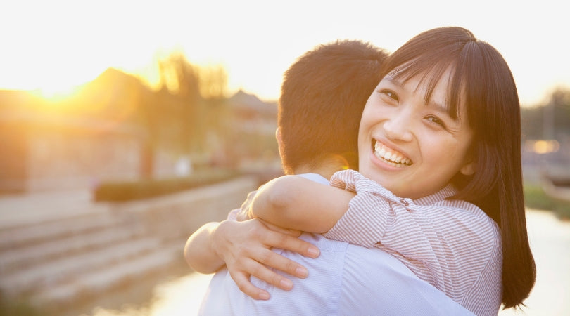 asian woman hugging and happy mood