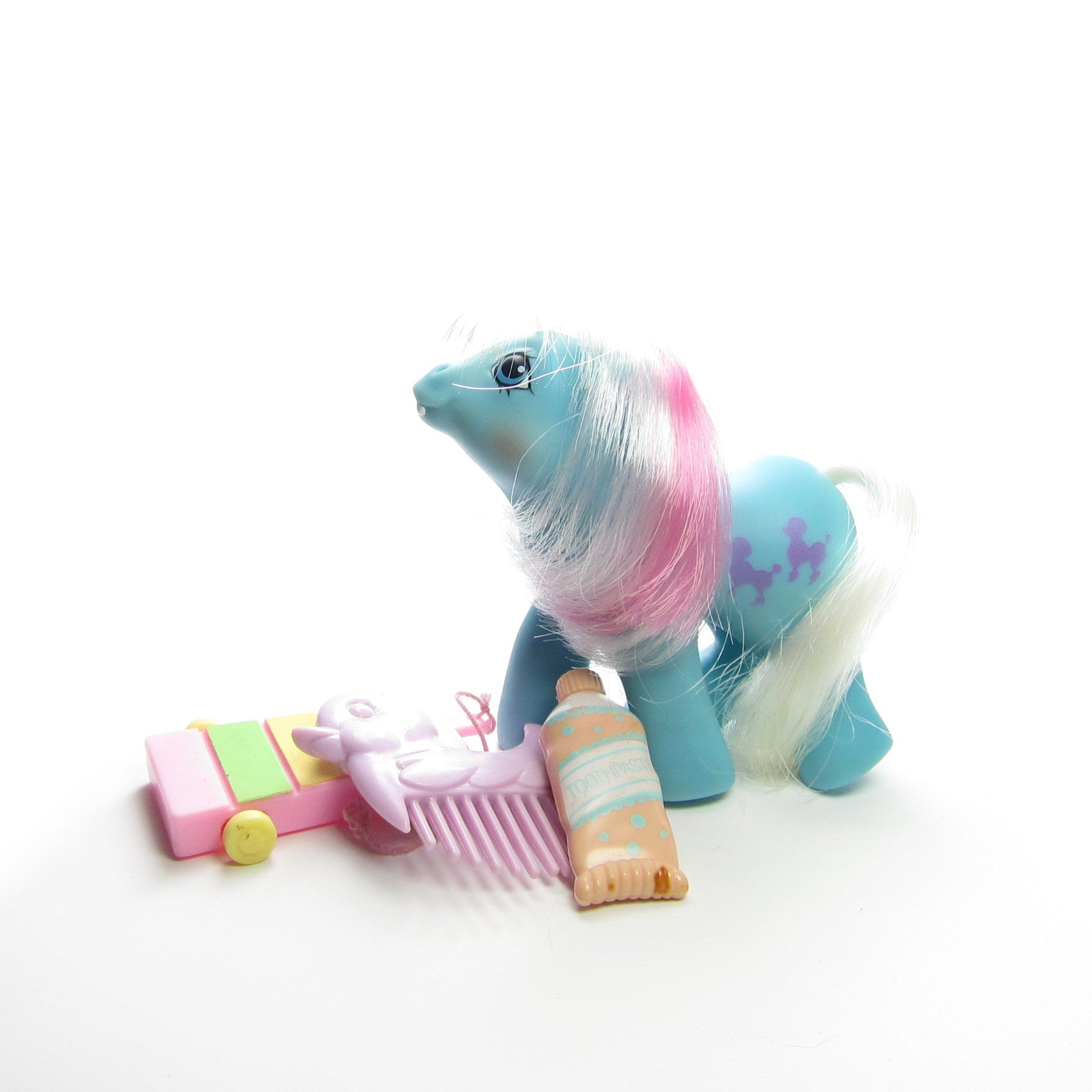 Baby Fifi with xylophone, comb, and toothpaste