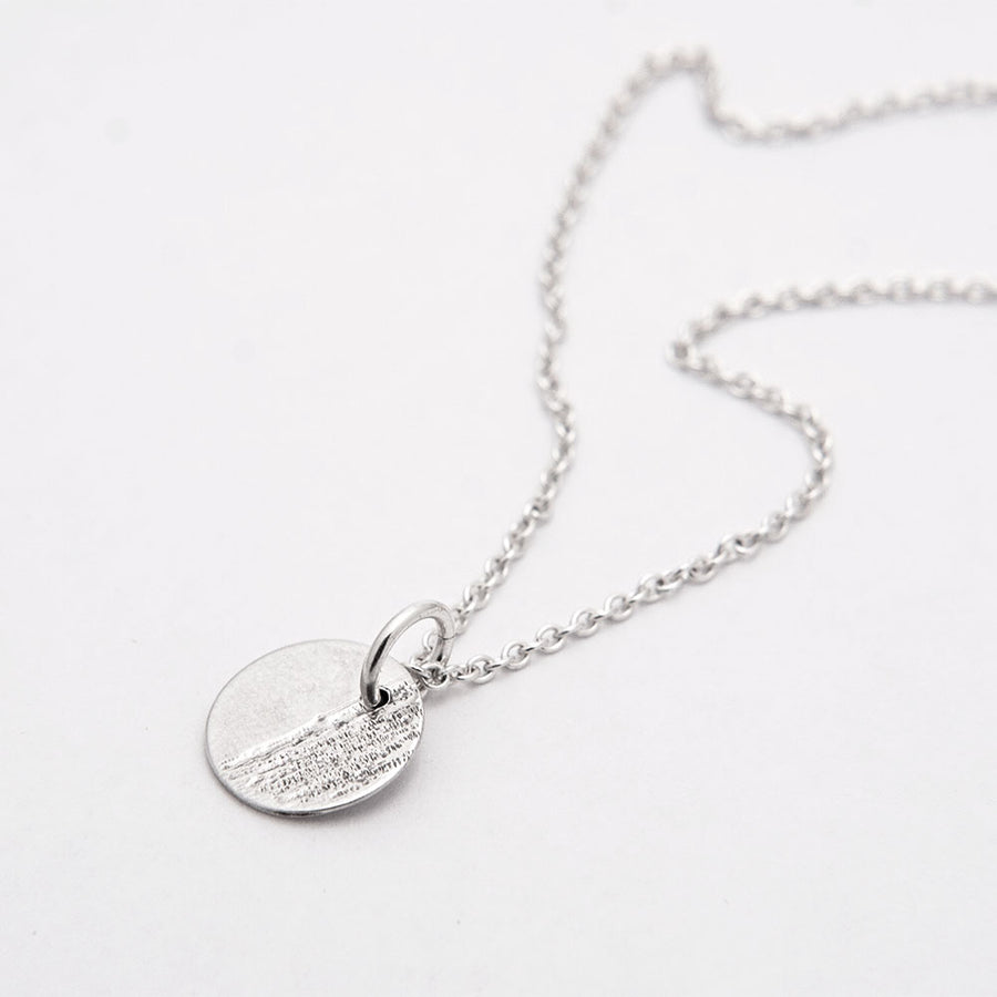 Maya Sterling Silver Disc Necklace available at Micky Chase Jewelry