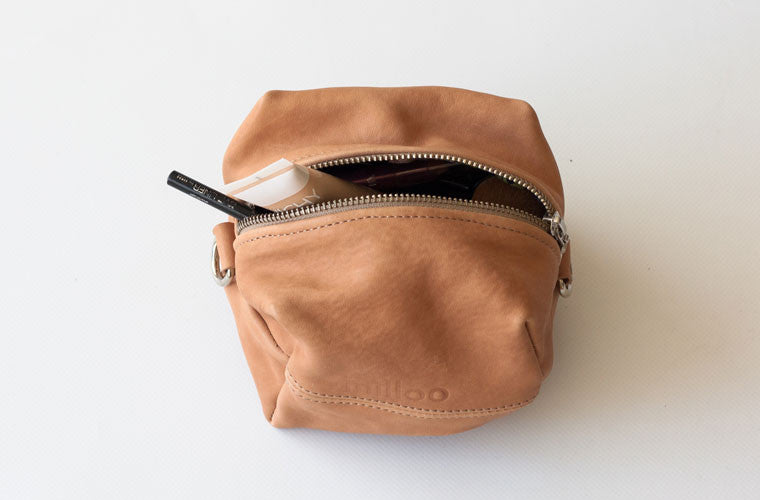 The Cube accessory bag in brown leather by milloo
