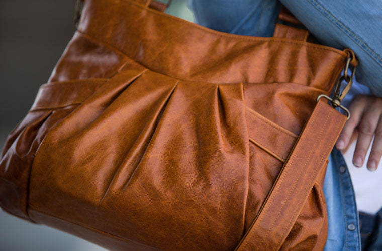The Elessa messenger bag in brown leather close shot by milloo