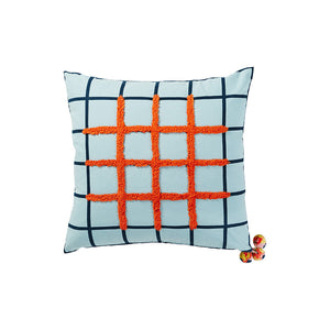 A reversible cushion defined by a hand printed grid pattern and embellished with rouge tufting and a trio of colourful handmade pom poms