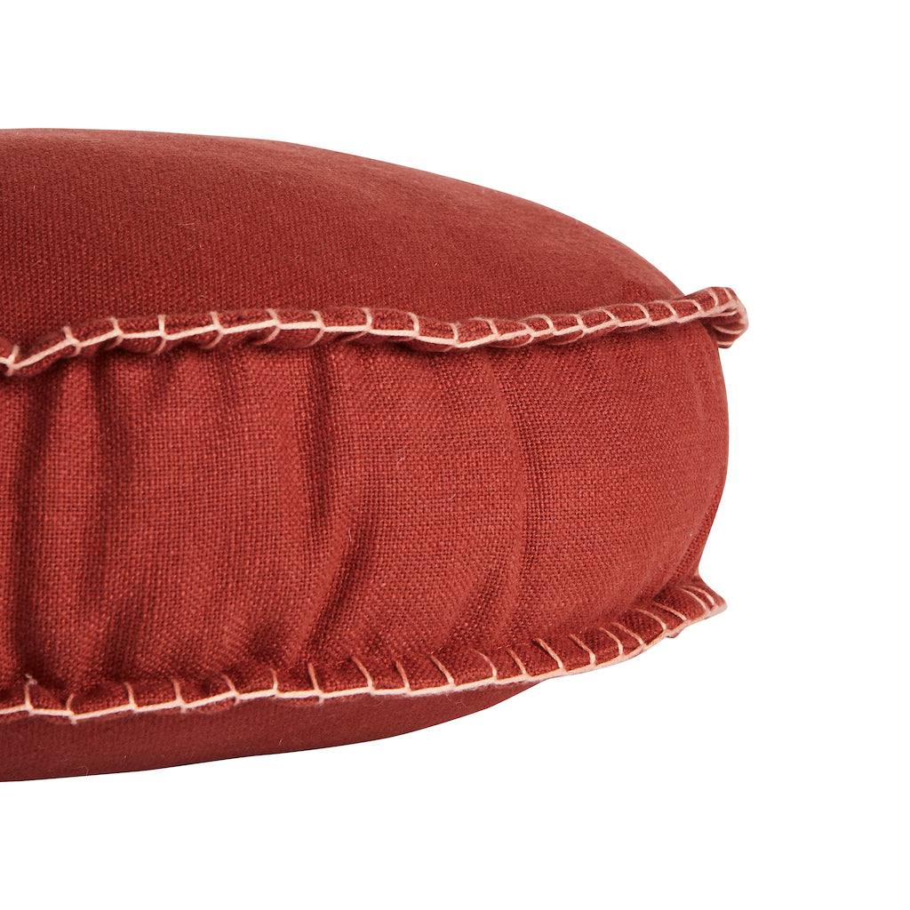 Rylie Round Cushion. Textured cotton round cushion in a brick colour way.