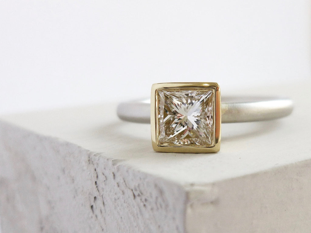 Bespoke contemporary platinum and 18ct yellow gold square diamond engagement ring, handmade to commission in Herefordshire