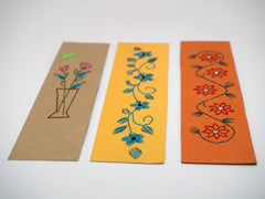 three floral bookmarks embroidered by hand