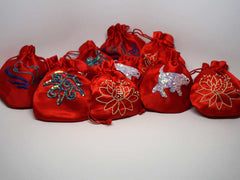 10 assorted red pouches with handmade embroidery