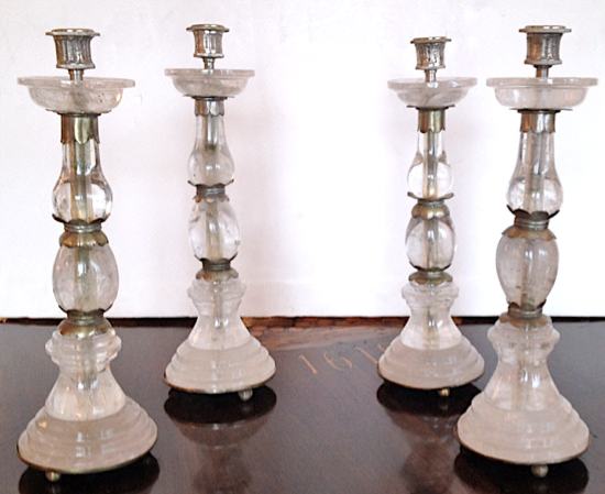 Polished rock-crystal candlesticks with silver mounts