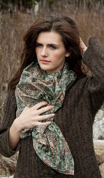 "Carley Kahn ""Emerald Forest"" silk scarf. Model is holding scarf around her neck."