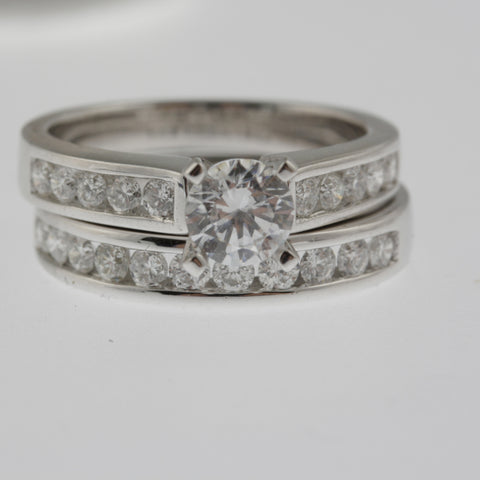 Diamond solitaire ring round brilliant with channel set round diamond shoulders in 18 ct white gold