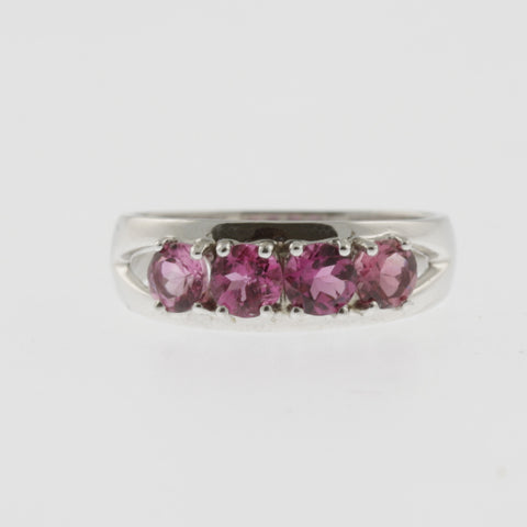 Four round pink sapphires 9 ct white gold band