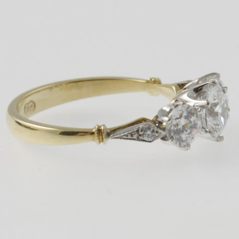 Triple diamond ring with diamond shoulders in white and yellow gold