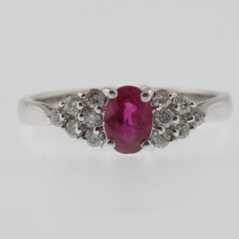Ruby oval with diamond triangular shoulders white gold ring