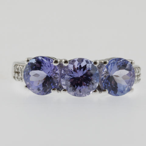 Triple round tanzanite and diamond ring in white gold