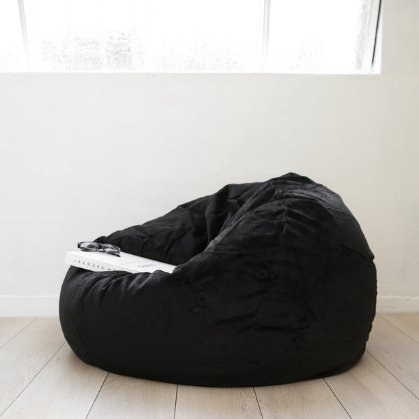 black velvet fur beanbag with a chanel book plus a pair of reading glasses