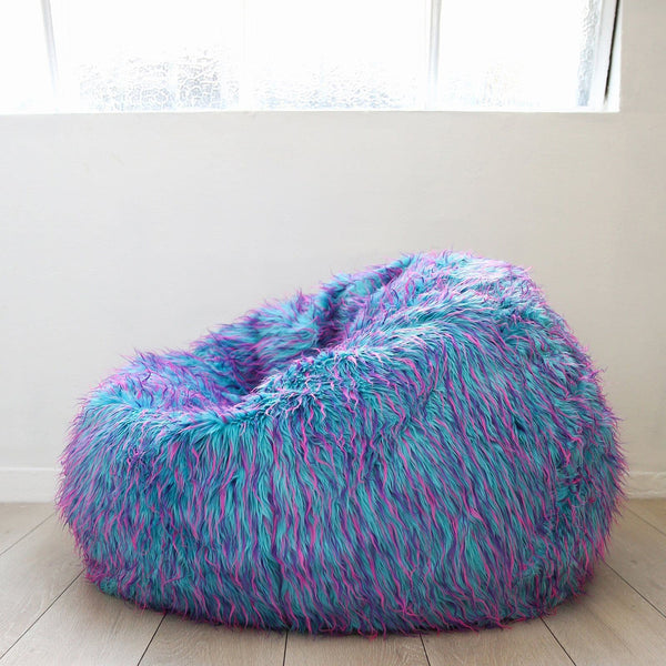 colourful fur beanbag on a wooden floor underneath a warehouse window