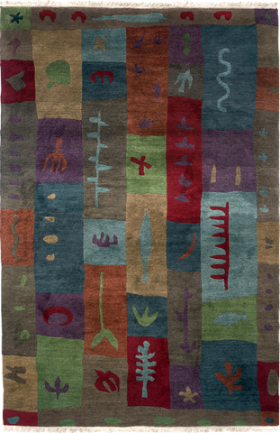 Blockprint is a colorful and fun hand-spun Tibetan wool rug designed by Laurie Downing.