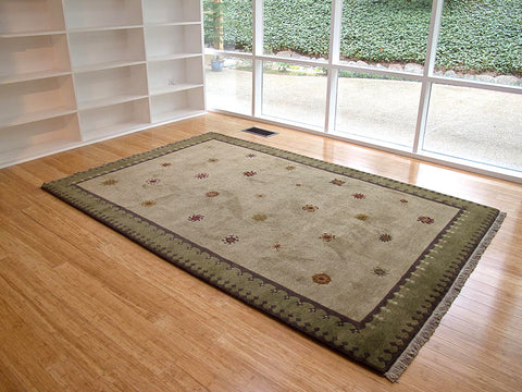 Tibetan Sun (sage)  - modern area rug in room