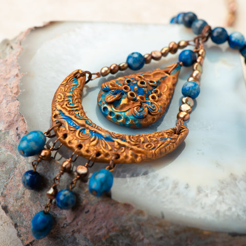 handmade necklace made of clay, lapis, and fresh water pearls.