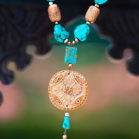 Fashion statement necklace made of clay, turquoise and fresh water pearls.
