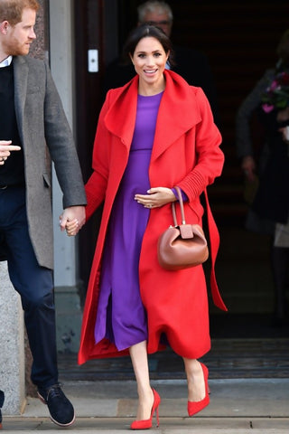 Megan Markle wearing bright colored stiletto high heels