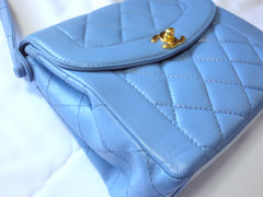Vintage CHANEL Rare color milky blue, lambskin classic shape handbag with gold tone CC closure.  Daily purse.