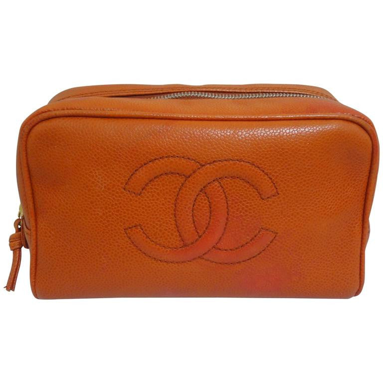 Vintage CHANEL orange caviar leather travel cosmetic, jewelry, toiletry case pouch with large CC stitch mark. Best vintage Chanel gift