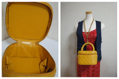 Vintage CHANEL yellow quilted lambskin cosmetic, make up case, vanity bag with CC mark at bottom. Can be a mini handbag. Get a lucky color