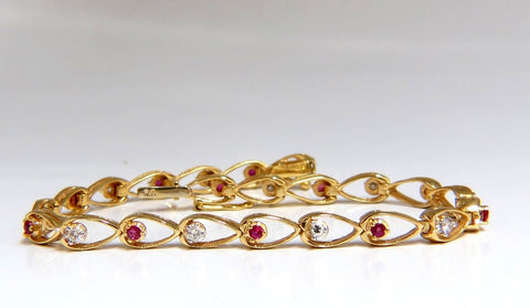 1.00ct natural ruby diamond pear form outline bracelet 14kt
