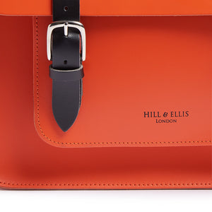 Hill and Ellis Jasper Dutch Orange Leather Pannier front view showing buckle and logo