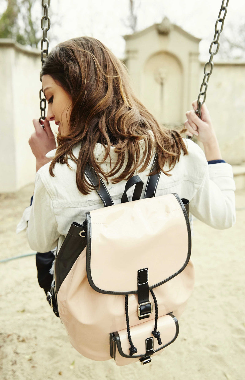 blush pink backpack chic and luxurious with patent leather, glossy.