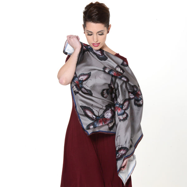 Model wearing Chetna Singh grey butterfly print square silk scarf.