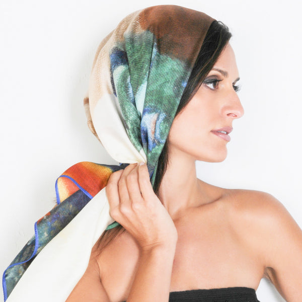 Model wearing Chetna Singh multi-colour face and flower print square silk scarf.