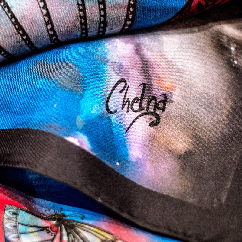 Close-up of Chetna Singh multi-color butterfly print long silk scarf.